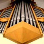 The pipes of First Lutheran Church's organ loom ominously over the choir balcony.  Built in 1990 by Rick Darrow, the organ is still played every Sunday morning. Long-time member Mrs. K. has been the primary organist since its installation in the church.
