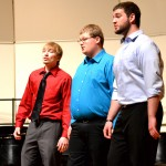Nate Hettinger, Kade Herrig, and Scott Kruse perform with Eclectix. Kruse is a four-year senior member.