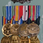 A small number of Drew's medals hang in the front room of his family's house. He shrugs them off and doesn't see a point in telling stories about how he earned them.