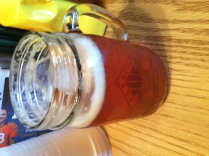 A mason jar filled with chilled Fat Tire lager. Yes, please.