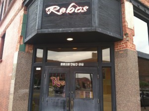 Signage above the door at Rebos