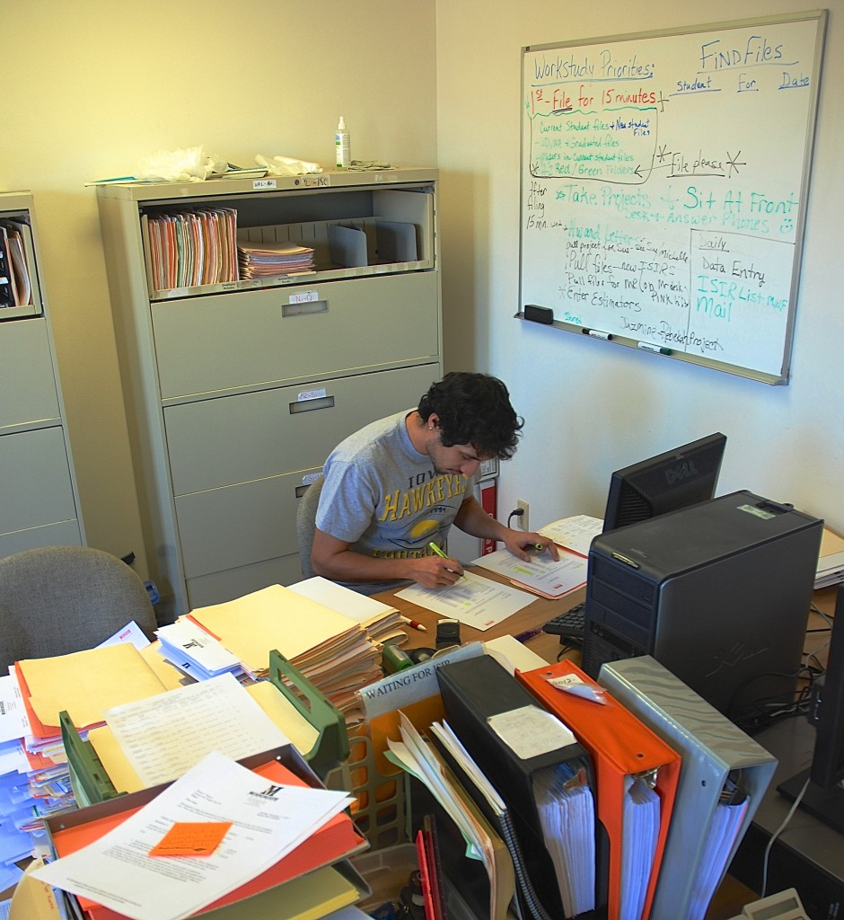 Fernando Franco keeps busy in between classes and homework by putting in a few hours a day at his work study job in the Financial Aid office at Morningside College.