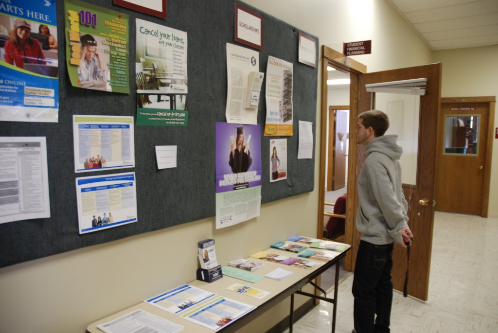 Tyson Osborn checking out the latest postings for scholarships outside of the Financial Aid office at Morningside College.