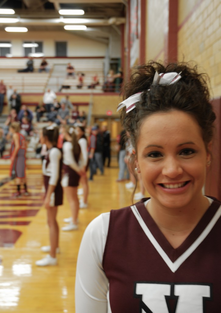 Rachel Penning takes a break from leading the cheers at the Morningside vs. Northwestern basketball game to pose for the camera.