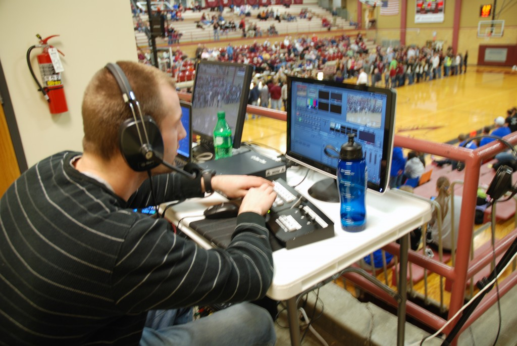 """It's not as hard as it looks,"" says Gage Thackston directing the cameras for Morningside College's MCTV at last night's basketball game."
