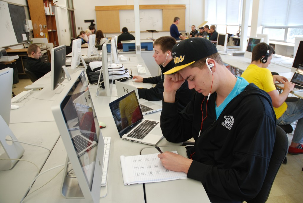 Drew Dau, and his fellow peers, hard at work in their Graphic Design class, working on some drafts for his next assignment.