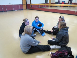 Dance team girls gossiping before practice.