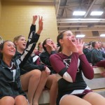 As members of the spirit squad, Calina Connor, Katie Weis, Meghann Pucelik, and Kara Bentz, cheer on the basketball team