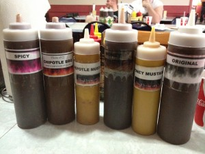 The array of sauces placed on each table at the House of Q