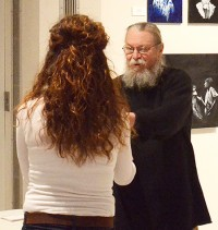Art Dept. Chair John Bowitz presents Cameron Oakley with an award during a gallery reception.