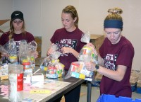 (L-R) Courtney Scheffler, Katie Atkins, Tiffany Shepherd at the Food Bank of Siouxland.