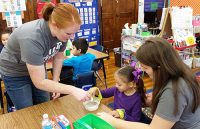 Summer Beery (left) and Sara Wede (right) lead an activity at Hunt Elementary.