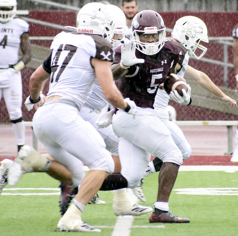 Mustangs cruise in FB opener (photos)